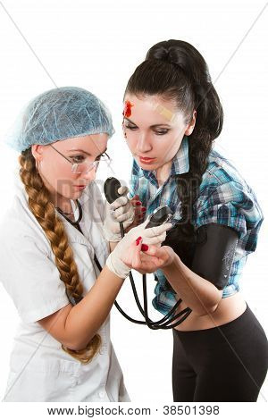 Female Medical Doctor Or Nurse  Giving Checkup With Stethoscope To Young Patient Over White Backgrou