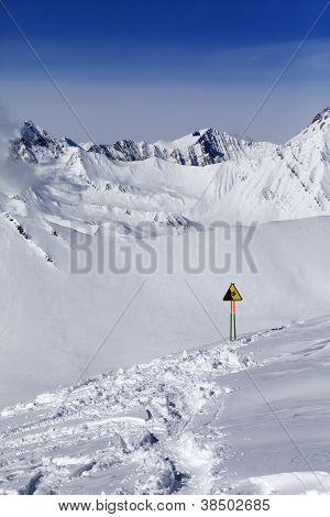 Warning Sing On Snow Slope