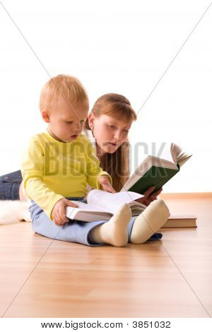 Cute Boy With Mother Reading A Book