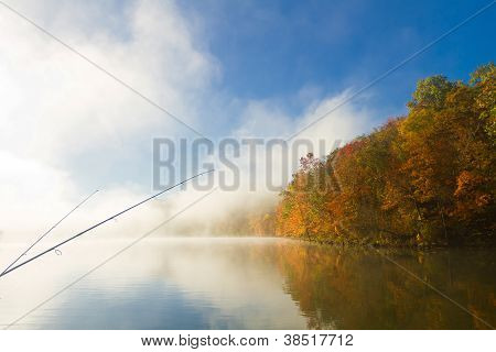 foggy morning in Missouri lake, fishing poles