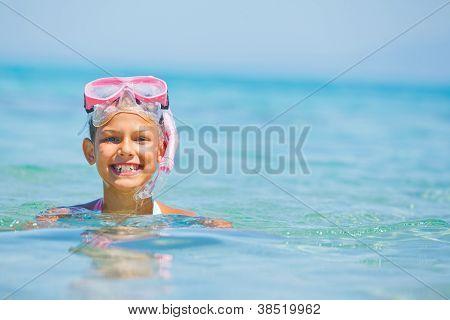 Cute girl playing in the sea