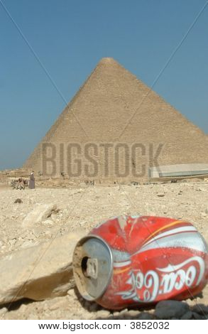 Discarded Can Sits In Front Of The Great Pyramid In Egypt, Representing 'Globalisation'/'T