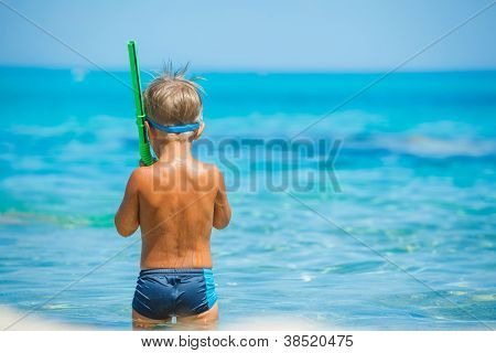 Cute boy playing in the sea