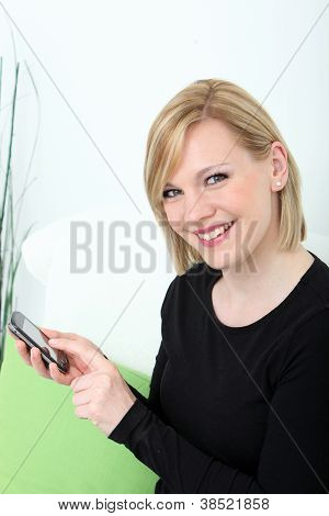 Smiling Woman Sending A Text Message