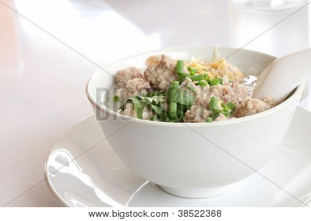 Pork congee and fried garlic on morning table.