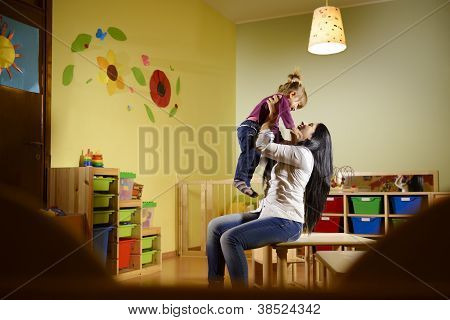 People And Fun, Teacher Playing With Little Girl At School