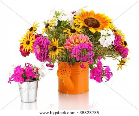 Beautiful bouquet of bright flowers in bailer isolated on white