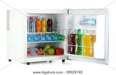 mini fridge full of bottles of juice, soda and fruit isolated on white
