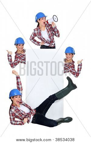 Excited construction worker publicizing a blank board