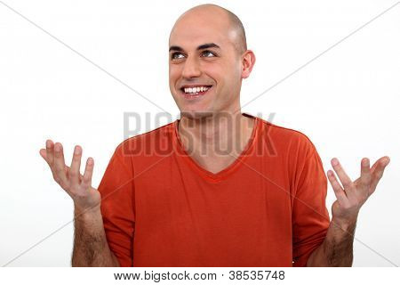 Man holding his hands up and laughing