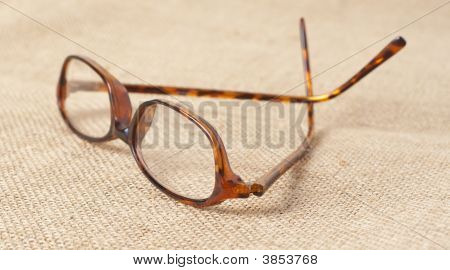 Horn-Rimmed Glasses On Material