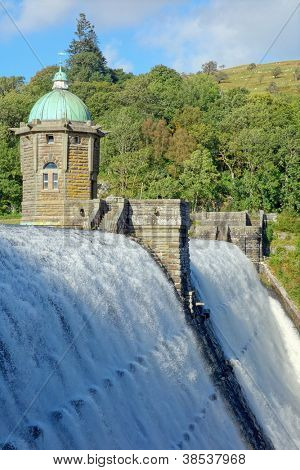 Penygarreg reservoir overflowing water, Elan Valley, Wales.