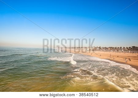 Huntington Beach, California in the morning shows the tides changing during a sunny weekend.