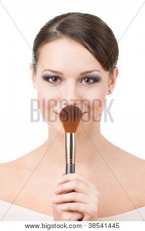 Woman with cosmetic brush for powder, isolated on white