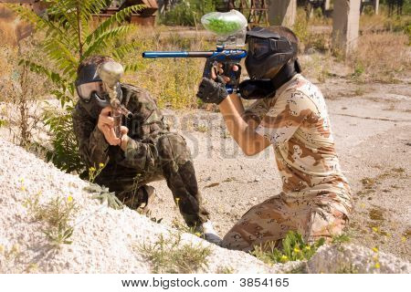 Paintball Players Hunting Outdoors