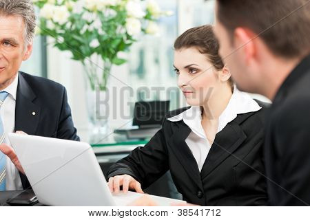 Business - team meeting in an office, the boss with his employees