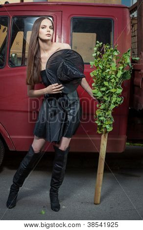 urban witch with a broomstick on the street