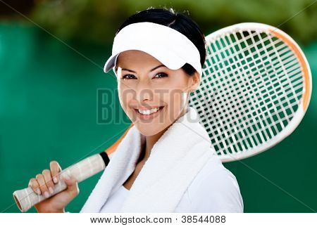 Close up of tennis player with towel on her shoulders