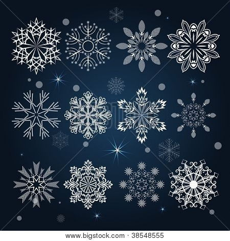 Set of snowflake shapes isolated on dark blue background.