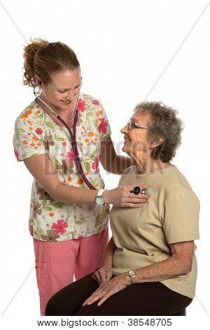 Friendly Nurse Check Elderly Senior Isolated on White Background