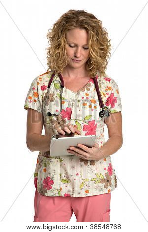 Blond Nurse with Natural Looking Smile Wearing Flower Patterned Scrubs Holding Tablet Computer on Isolated White Background