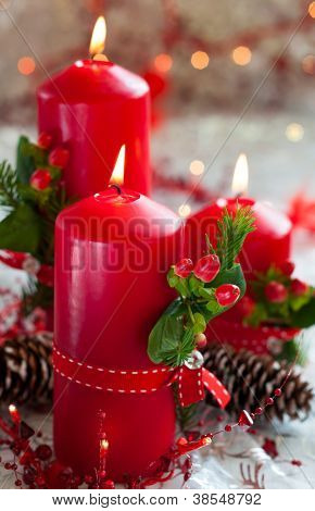 Three Red Christmas candles with decor