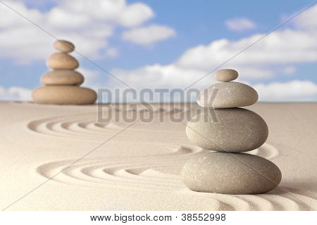 Spirituality and balance in a Japanese zen garden Sand and stone pattern concept for relaxation and concentration