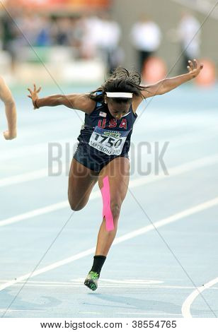 BARCELONA - JULY, 11: Jennifer Madu of USA during 100 metres event of the 20th World Junior Athletics Championships at the Olympic Stadium on July 11, 2012 in Barcelona, Spain