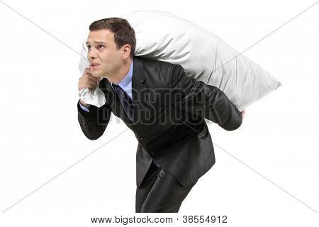 A businessman carrying a money bag isolated on white background