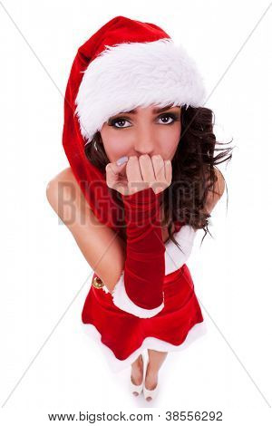 closeup picture of a beautiful young woman in christmas clothes looking scared or curious into the camera, isolated on white
