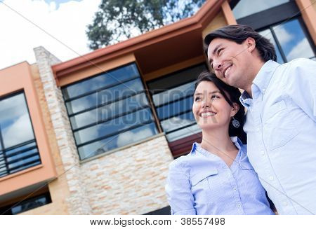 Couple daydreaming of buying a beautiful house