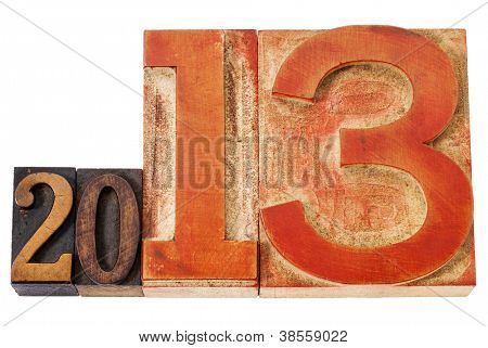 year 2013  - isolated text in vintage letterpress wood type, mixed fonts with oversized number thirteen
