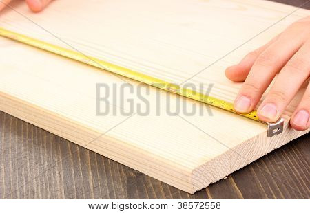 measuring wooden board close-up