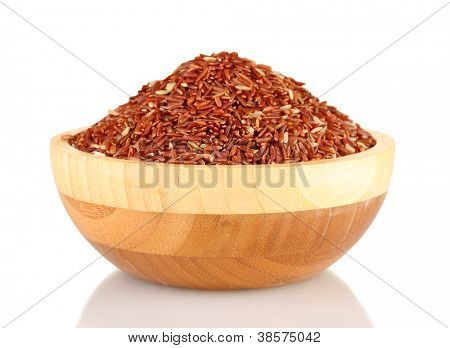 red rice in a  brown wooden plat, isolated on white