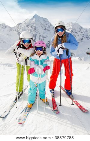 Skiing, winter fun - happy family ski team
