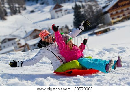 Winter, snow, family sledding at winter time