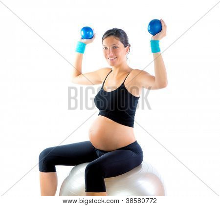Beautiful pregnant woman at fitness gym with toning balls on aerobics