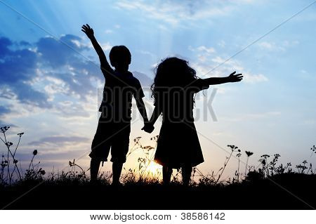 Little brother and sister silhouette