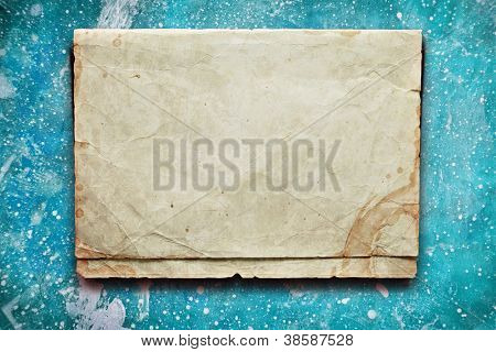 Vintage blue background with old paper and coffee stain