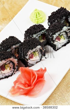 sushi roll with tuna, avacado, sauce and flying fish roe