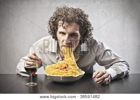 Man gorging of spaghetti and drinking wine