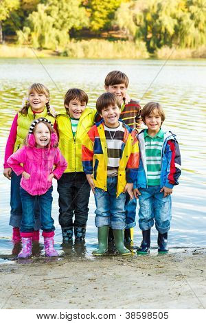 Cute kids group in rubber boots