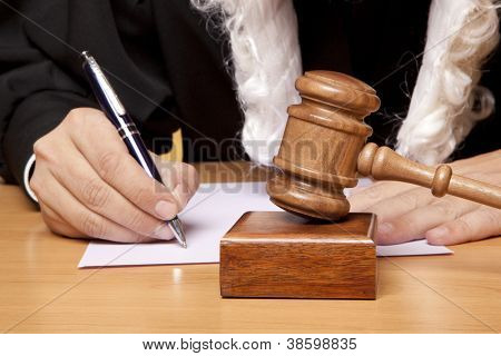 Referee hammer and a man in judicial robes
