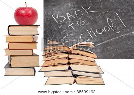 Back to School written on a blackboard with books and red apple