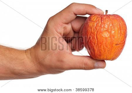 Man hand with stale apple isolated on white background