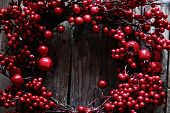 image of winterberry  - Photo of christmas garland on wooden background - JPG