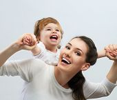 image of snuggle  - happy mother holding her baby - JPG