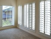 picture of interior  - White plantation style wood Shutters for luxury Interior Design in condo - JPG