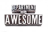 The phrase Department of Awesome in letterpress type over white. Slight cross process effect.