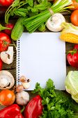 Fresh Organic Vegetables and Spices on a Wooden Background and Paper for Notes.Open Notebook and Fre